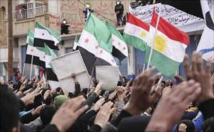 kurdish and syrian flags