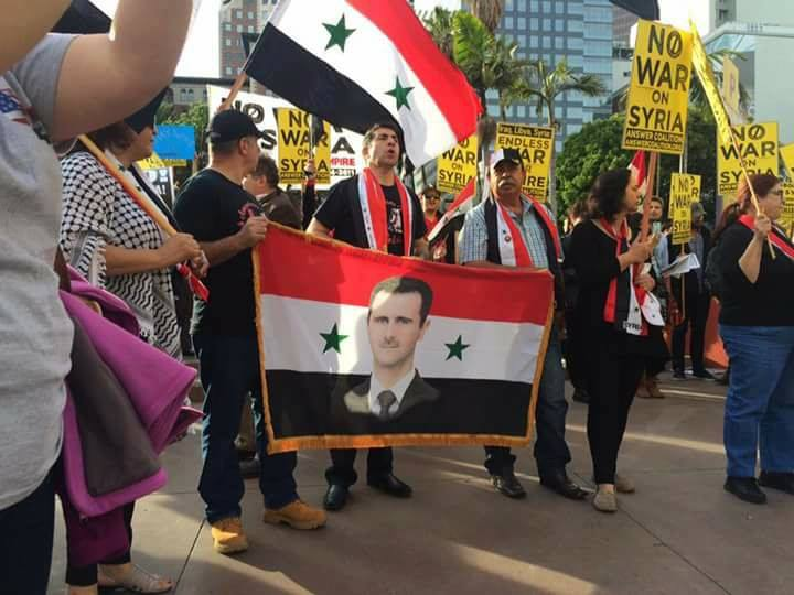 assad-portraits-at-the-antiwar-protest