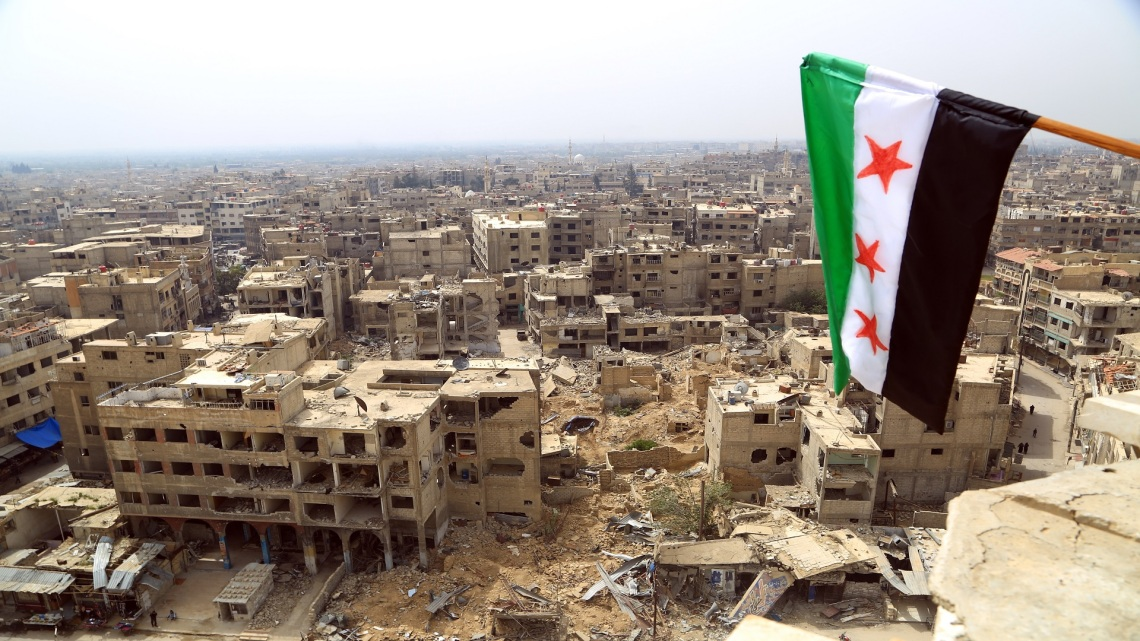 Free Syrian Army flag hung on Douma Great Mosque